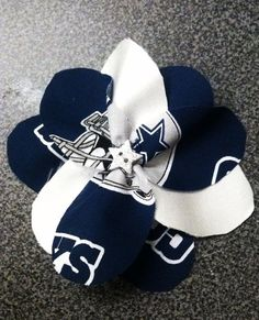 All NFL teams and some College teams are available with this fabric flower pin made by yours truly!