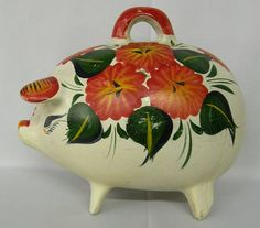 Mexican hand painted Piggy Banks - I had one of these when I was little and I want one!! The old school kind that you have to break open with a hammer! :)
