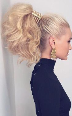 Don't miss out on the big ponytail trend this spring - all it takes is some clever teasing and a huge claw clip accessory #ponytail #hairstyle