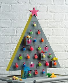 Learn to make a funky neon tree advent that makes a change traditional Christmas colours. A great craft for teens or anyone that wants to get involved!