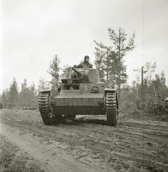 Finnish light tank T-26 with turret from the BT-7 during the attack on the city of Olonets. September 1941. Pin by Paolo Marzioli