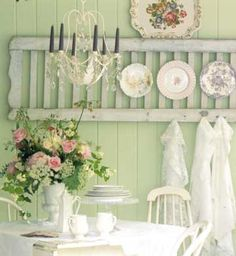 Layering plates on a fun piece like this is another charming way to display them. Try an old door, a fence post, old window pane, etc….