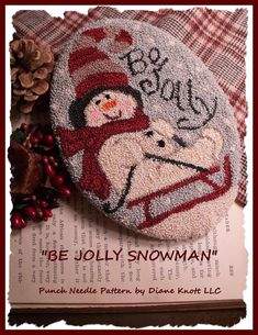 My Be Jolly snowman, on his little sled, scarf and striped winter hat, downloadable pattern needlework design, is one of my newest ventures, punch needle patterns...many were inspired by my previously licensed watercolor art images.  The downloadable pattern only has 4 pages, so you wont be wasting a lot of ink. It comes with a full color cover, a full-size traceable, reusable pattern, a suggested list of materials, and simple, basic instructions. The finished design is approximately 7 high…
