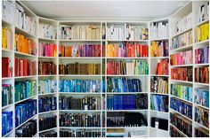 Roomful full of rainbow-hued books