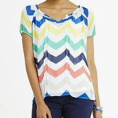 Multicolor zigzag print NWT multicolor zigzag top, comes with a white cami underneath. The tag says size small but can fit a medium. zac & rachel Tops