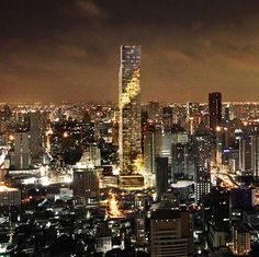 German architect Ole Scheeren of Office for Metropolitan Architecture has designed a skyscraper for Bangkok in Thailand. Called MahaNakhon, the building consists of a 77-storey glass tower. A band of shifted, box-like elements breaks up the surface and creates terraces and balconies. There will also be a public plaza, retail space, 200 homes, a hotel,