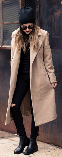 Raquel Paiva is wearing a black and camel outfit