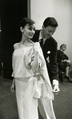 Audrey Hepburn being fitted by Hubert de Givenchy, Paris, 1956.