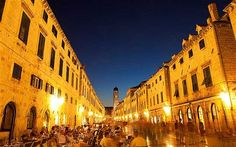Dubrovnik's Stradun, formerly a swamp, is now the pulsating centre of the city, with its many shops, cafés and restaurants. Paved by white l...
