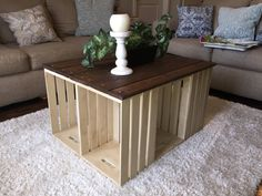 """This table is so lovely it looks like it should be in a charming, country French cottage (or your living room, of course!). In this design I envisioned that look and stained different sizes of pallet wood in Dark Walnut and painted the wooden crates with a creamy colored chalk paint, followed by distressing and a coat of wax to protect and seal your piece. 32 L, 26 W and 19 H. Each crate opening measures 12"""" x 16.5"""" -6 wooden wine crates -7 pallets of wood   *If youd like a custom order…"""