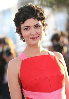 A curly, slightly grown out pixie cut looks feminine and low maintenance on Audrey Tautou. #hairstyle #shorthair