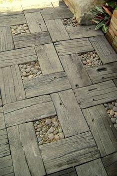 I'll bet my FIL has some wood I could use to make a walkway to the car! Reclaimed wood with stones garden walkway design