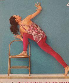 Parivrtta Parsvakonasana variant. Practice note: Put chair on non-stick mat to prevent it from slipping.