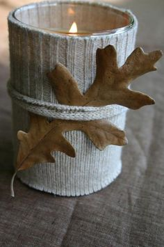 Simple but cute candle holder.  No instructions but use the bottom half of a sleeve from a sweater cut the the length of your votive.  Tie the leaf with a matching piece of sweater or coordinated ribbon.