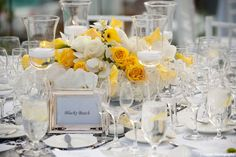 loving the yellow roses and the set out of the center piece