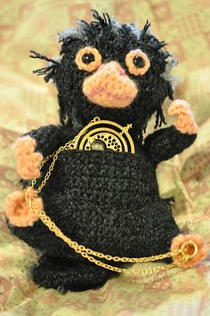 Norman the niffler keeps stealing my shiny things!! I decided to share this pattern with the world so you can all make a niffler to steal your shiny things!