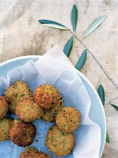 Arancini with porcini and basil: these crisp-edged, fried risotto balls with their molten mozzarella filling are a complete delight. Recipe Alice Hart, photograph Con Poulos. http://www.hglivingbeautifully.com/2015/07/25/a-relaxed-italian-feast/