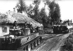Tiger 1 tanks with the schwere Panzer Abteilung 503 moving through a Russian village