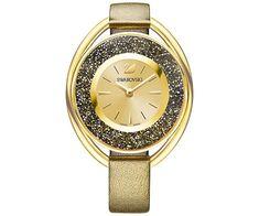 Mit dieser schlanken, vielseitig tragbaren Crystalline Oval Armbanduhr ziehen Sie alle Blicke auf Ihr Handgelenk. Dieses Design ist fest in der DNA von Swarovski verankert. In dem Zeitmesser mit einem Edelstahlgehäuse in vergoldetem Finish funkeln rund 1.700 braune Kristalle. Das Zifferblatt in hellgoldenem Sonnenstrahl-Finish und das goldfarbene Lederarmband runden die Kreation perfekt ab. Gehäuse – 37 mm, wasserdicht bis 30 m Tiefe, Quarzwerk Swiss Made.