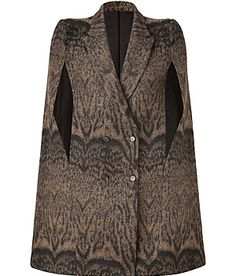 ROBERTO CAVALLI  Toffee/Black Wool-Blend Cape                 A contemporary way to wear the brand's iconic look outdoors, this wool-blend cape from Roberto Cavalli lends a glamorous finish to any outfit            Peaked lapel, side arm slits, double-breasted buttoned front            Boxy loose fit            Wear with sleek knit tops, leather leggings and high-heel booties