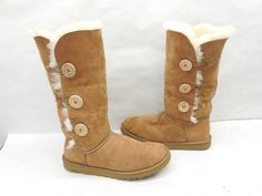 - The adorable Bailey Button Triplet is a must-have addition to your Australia boot collection. - Twin faced sheepskin uppers with suede heel guards for added structure. - Boot cuff can be worn up or