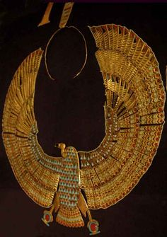 Tutankhamun's Flexible collar of Nekhebet (vulture) with superb workmanship, made up of 256 gold plaques inlaid with polychrome glass and threaded together with borders of tiny beads.