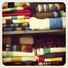 Piles of Hudson Bay Blankets via @Diamondsandrustshop/Instagram