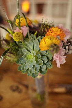 I like the use of succulents but I'm not sure I would want a succulent bouquet. Maybe more for centerpieces.