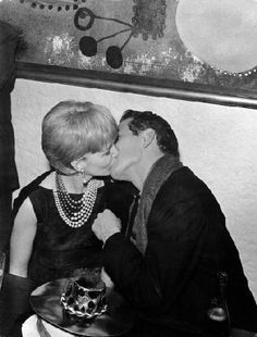 Paul Newman and Joanne Woodward sharing a New Year's Eve kiss - 1961