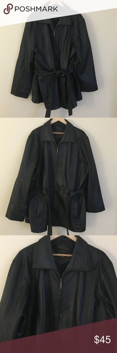"""Outbrook Woman XL black leather belted lined coat Trendy and sleek Outbrook Woman XL black genuine leather lined winter coat with matching belt. Dimensions taken while garment is laying flat and zipped: 21"""" across shoulders, 50"""" bust/waist/hips, 25"""" sleeve length, length from shoulder to bottom hem 30"""". Jacket is dry clean only being 100% leather with an acetate lining. Outbrook Woman Jackets & Coats Utility Jackets"""