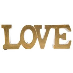 gold freestanding 'love' sign   #ascrentals #asouthernceremony #charleston #weddings