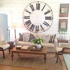 The antique metal clock face is finally up! #biggerthaniremembered #timeisagift (coffee table and Olive bucket available @magnoliamarket in waco)