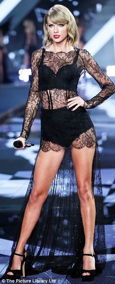 Cheeky: Taylor showed off her pert derriere in a pair of lace underwear as she performed a...