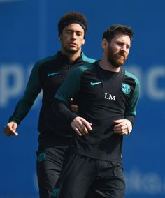 Lionel Messi and Neymar of Barcelona jog during a FC Barcelona training session on the eve of their UEFA Champions League quarter final second leg match against Juventus at FC Barcelona Sports Centre on April 18, 2017 in Barcelona, Catalonia.