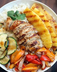Grilled Hawaiian Chicken Teriyaki Serves 4 Ingredients 4 or 5 boneless, skinless chicken tenders 1 zucchini, sliced 4 mini sweet bell peppers, any color, chopped 1/2 of a pineapple, peeled and cut into spears 1 small red onion, sliced thin 1/2 cup toasted sweetened coconut flakes, optional For the Coconut Rice 2 cups water 1 1/2 cups canned unsweetened coconut milk (about one 13.5 oz can) 2 tsp packed light brown