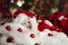This baby dreaming of a new binky: | 29 Babies Who Totally Nailed Their First Christmas Photo Shoot