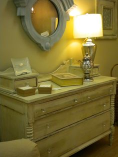 This chest used to have a mirror attached; but I didn't like the way it looked; so I cut it off. I painted and distressed it and added the glass knobs.