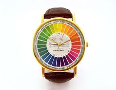 Vintage Color Wheel Watch, Ladies Watch, Men's Watch, Collage, Unisex, Vintage Inspired, Collage, Analog, Gift Idea by 10northcreative on Etsy https://www.etsy.com/listing/198428485/vintage-color-wheel-watch-ladies-watch