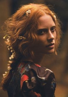 I love flowers and leaves weaved into red hair it looks so natural and wild.