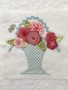 Block 38 of The Splendid Sampler quilt.  I added the bee.