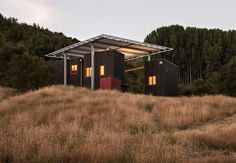 Built by Sarosh Mulla Design in Gisborne, New Zealand with date 2015. Images by Simon Devitt. The Longbush Ecosanctuary Welcome Shelter is an innovative environmental education space designed, constructed and op...