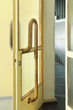 form & function: curved wood and metal door handle