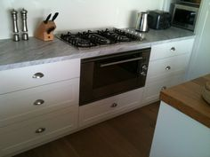 Carrera Marble with polyurethane finished shaker style drawer fronts