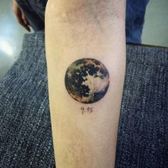 Realistic moon tattoo on the forearm. Tattoo artist: Doy