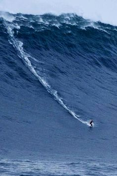 Surfing legend Garrett McNamara riding a 100-ft wave in Nazare, Portugal, perhaps the world's biggest wave ever surfed, Jan 2013.