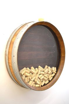 Have a cork collection and need an amazing way to store it?  We take a retired Napa wine barrel and screw it together before sanding and