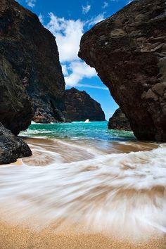 Swim, sail, or jump from the cliffs that surround Kauai.