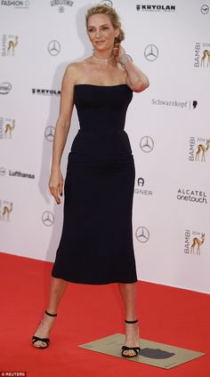 Enviable shape: The actress's dress cut in at her narrow middle and followed the line of h...