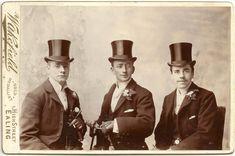 Victorian men in top hats.