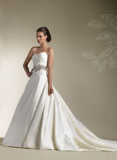 Justin Alexander wedding dresses style 8598 Silk Dupion strapless sweetheart with asymmetrical draping , drop waist line, full ball gown with chapel length train. Includes a silk belt with beaded embellishments and buttons over back zipper.